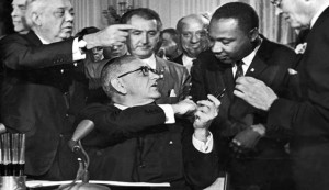 Lyndon Johnson with Martin Luther King, Jr. at the signing of the 1964 Civil Rights Act